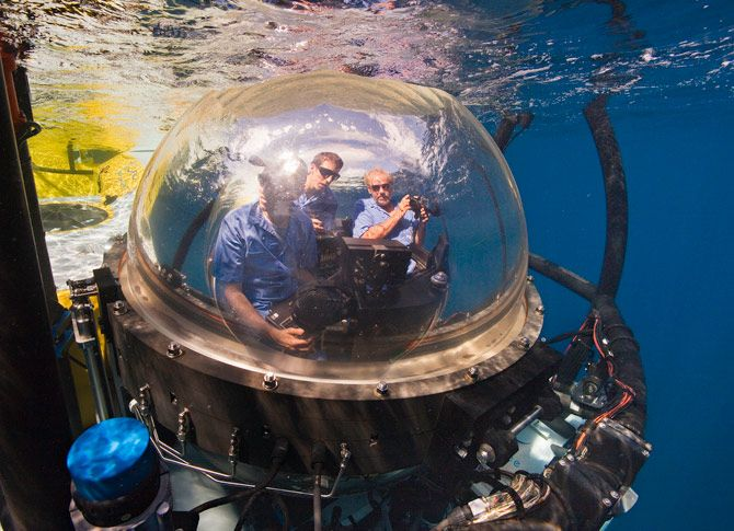 Photographer Brian Skerry, pilot Eli Temime, and author Gregory S. Stone (left to right) start their descent to Las Gemelas seamount aboard the DeepSee in a five-foot sphere with 360-degree views. The submarine, which can drop to 1,500 feet below sea leve